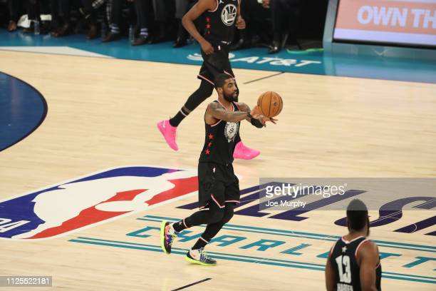 Kyrie Irving of Team Lebron passes the ball during the 2019 NBA AllStar Game on February 17 2019 at the Spectrum Center in Charlotte North Carolina...