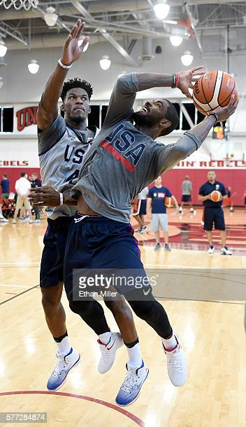 Kyrie Irving of the 2016 USA Basketball Men's National Team drives to the basket against Jimmy Butler of the 2016 USA Basketball Men's National Team...
