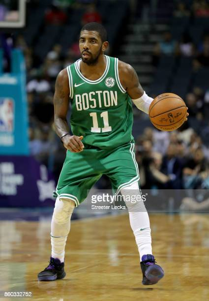 Kyrie Irving of the Boston Celtics against the Charlotte Hornets during their game at Spectrum Center on October 11 2017 in Charlotte North Carolina...