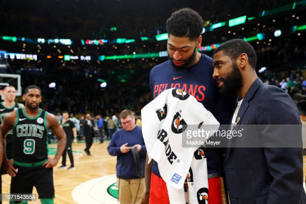 Kyrie Irving of the Boston Celtics and Anthony Davis of the New Orleans Pelicans talk after the game between the Celtics and Pelicans at TD Garden on...