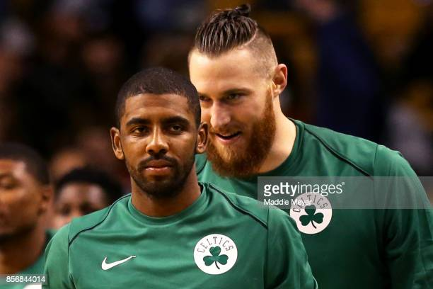 Kyrie Irving of the Boston Celtics and Aron Baynes look on from the bench during the second half against the Charlotte Hornets at TD Garden on...