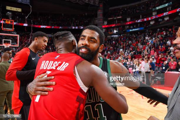 Kyrie Irving of the Boston Celtics and Danuel House Jr #4 of the Houston Rockets embrace following the game on December 27 2018 at the Toyota Center...