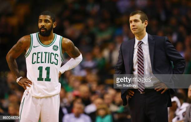 Kyrie Irving of the Boston Celtics and head coach Brad Stevens look on during the second half against the Denver Nuggets at TD Garden on December 13...