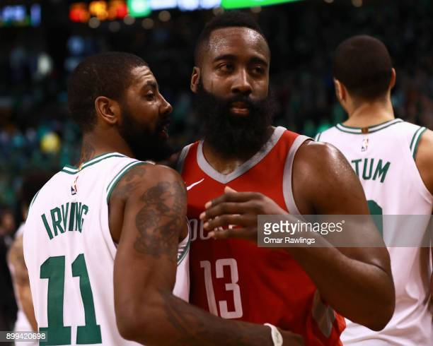 Kyrie Irving of the Boston Celtics and James Harden of the Houston Rockets embrace after the game at TD Garden on December 28 2017 in Boston...