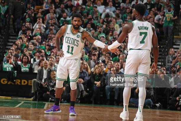 Kyrie Irving of the Boston Celtics and Jaylen Brown of the Boston Celtics during a game against the Milwaukee Bucks during Game Three of the Eastern...