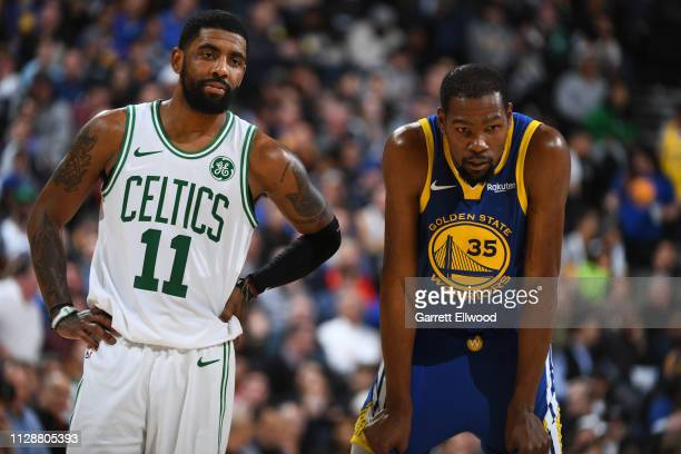 Kyrie Irving of the Boston Celtics and Kevin Durant of the Golden State Warriors looks on during the game on March 5 2019 at ORACLE Arena in Oakland...