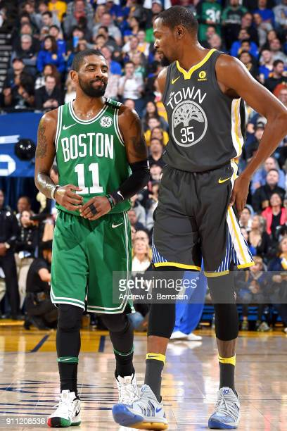 Kyrie Irving of the Boston Celtics and Kevin Durant of the Golden State Warriors speak during the game on January 27 2018 at ORACLE Arena in Oakland...