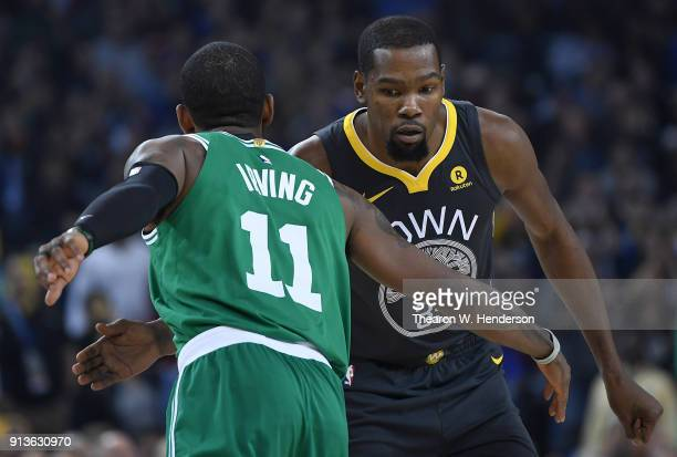Kyrie Irving of the Boston Celtics and Kevin Durant of the Golden State Warriors greet each other prior to the start of their NBA basketball game at...