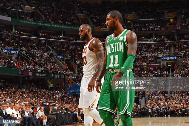 Kyrie Irving of the Boston Celtics and LeBron James of the Cleveland Cavaliers walk up court on October 17 2017 at Quicken Loans Arena in Cleveland...
