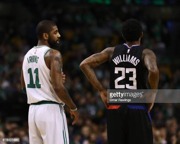 Kyrie Irving of the Boston Celtics and Lou Williams of the LA Clippers talk during the game at TD Garden on February 14 2018 in Boston Massachusetts...
