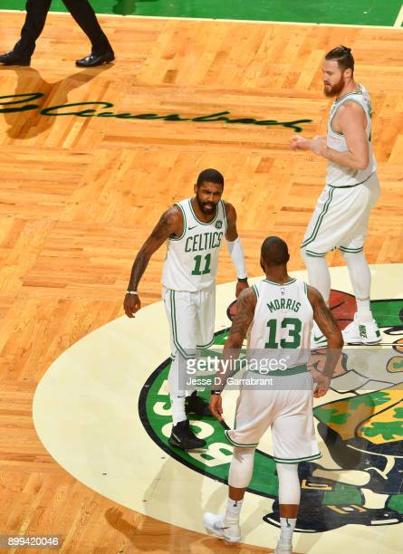Kyrie Irving of the Boston Celtics and Marcus Morris are pumped up during the game against the Houston Rockets on December 28 2017 at the TD Garden...