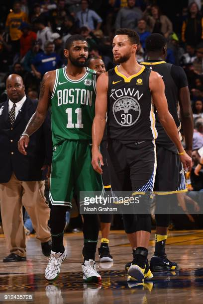 Kyrie Irving of the Boston Celtics and Stephen Curry of the Golden State Warriors look on during the game between the two teams on January 27 2018 at...