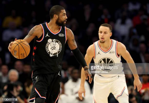 Kyrie Irving of the Boston Celtics and Team LeBron drives to the basket against Stephen Curry of the Golden State Warriors and Team Giannis during...