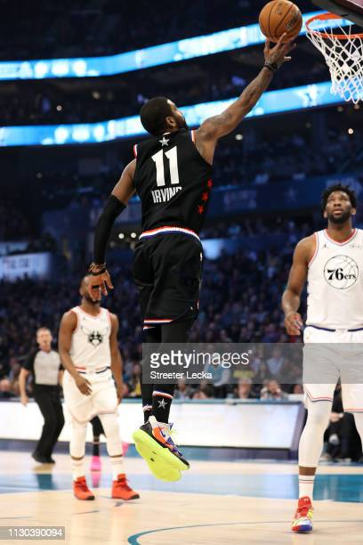 Kyrie Irving of the Boston Celtics and Team LeBron goes up for a shot against Joel Embiid of the Philadelphia 76ers and Team Giannis in the first...