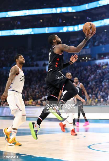 Kyrie Irving of the Boston Celtics and Team LeBron goes up for a shot against Paul George of the Oklahoma City Thunder and Team Giannis in the first...