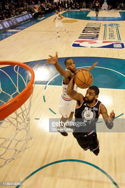 Kyrie Irving of the Boston Celtics and Team LeBron shoots against Khris Middleton of the Milwaukee Bucks and Team Giannis during the NBA AllStar game...
