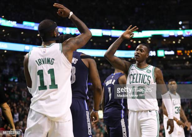 Kyrie Irving of the Boston Celtics and Terry Rozier celebrate during the second half against the Dallas Mavericks at TD Garden on December 6 2017 in...