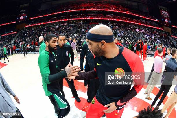 Kyrie Irving of the Boston Celtics and Vince Carter of the Atlanta Hawks exchange handshakes at the beginning of the game on January 19 2019 at State...