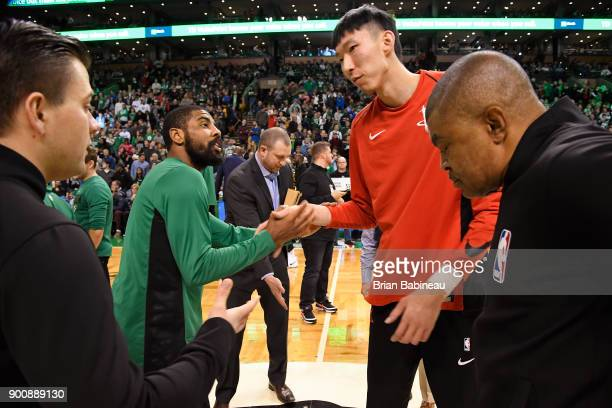 Kyrie Irving of the Boston Celtics and Zhou Qi of the Houston Rockets shake hands before the game on December 28 2017 at the TD Garden in Boston...