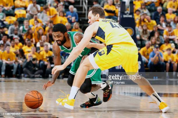 Kyrie Irving of the Boston Celtics battles for possession of the ball during the game against Bojan Bogdanovic of the Indiana Pacers during Game Four...
