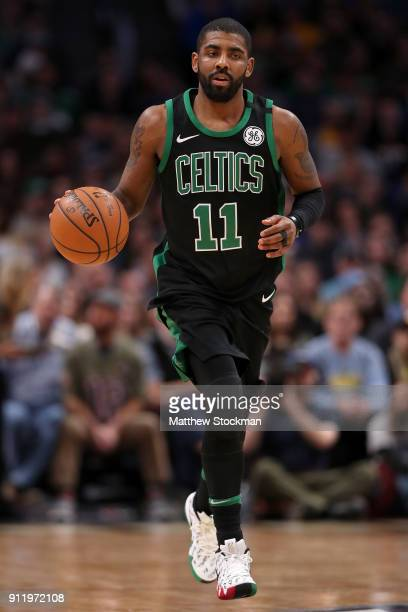 Kyrie Irving of the Boston Celtics brings the ball down the court against the Denver Nuggets at the Pepsi Center on January 29 2018 in Denver...