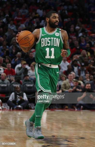 Kyrie Irving of the Boston Celtics brings the ball up the court during the third quarter of the game against the Detroit Pistons at Little Caesars...