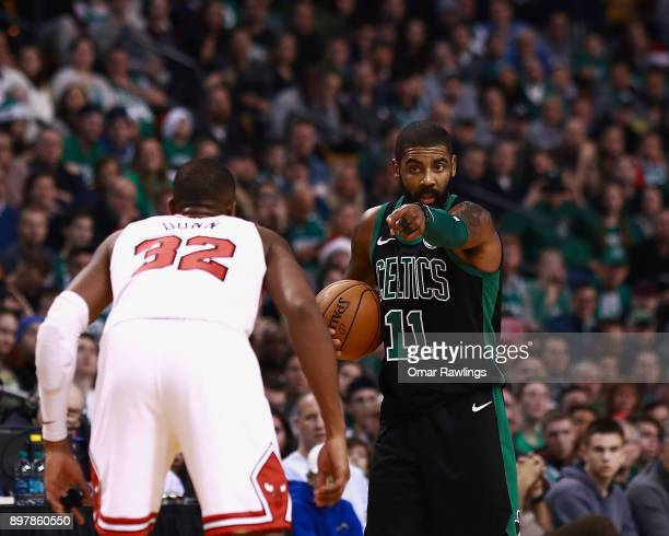 Kyrie Irving of the Boston Celtics calls a play during the second half of the game against the Chicago Bulls at TD Garden on December 23 2017 in...