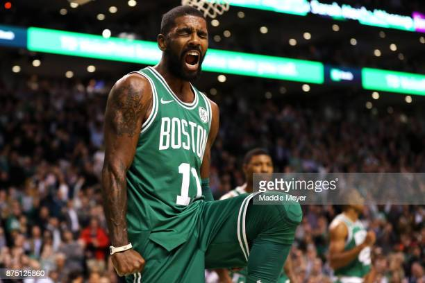 Kyrie Irving of the Boston Celtics celebrates during the fourth quarter against the Golden State Warriors at TD Garden on November 16 2017 in Boston...