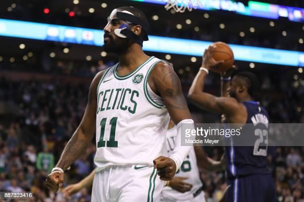Kyrie Irving of the Boston Celtics celebrates during the second half against the Dallas Mavericks at TD Garden on December 6 2017 in Boston...