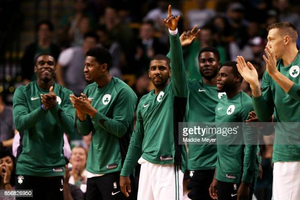 Kyrie Irving of the Boston Celtics center celebrates from the bench after Marcus Smart hit a three point shot during the first half against the...