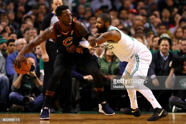 Kyrie Irving of the Boston Celtics defends Jeff Green of the Cleveland Cavaliers during he first quarter at TD Garden on January 3 2018 in Boston...