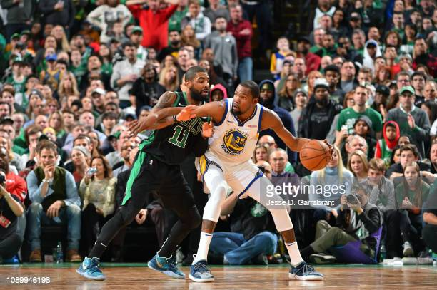 Kyrie Irving of the Boston Celtics defends Kevin Durant of the Golden State Warriors on January 26 2019 at the TD Garden in Boston Massachusetts NOTE...