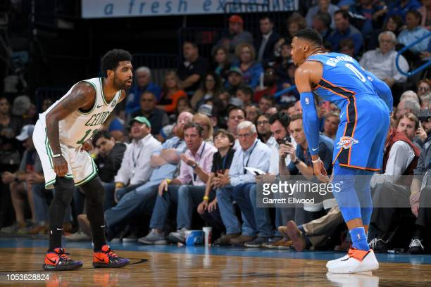 Kyrie Irving of the Boston Celtics defends Russell Westbrook of the Oklahoma City Thunder on October 25 2018 at Chesapeake Energy Arena in Oklahoma...