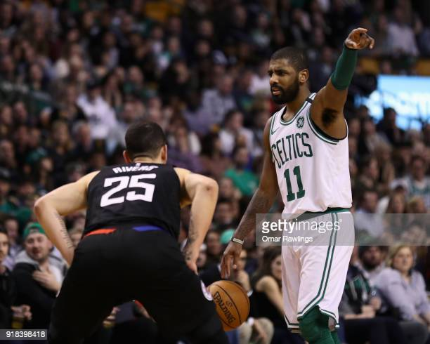Kyrie Irving of the Boston Celtics directs the offense during the fourth quarter of the game against the LA Clippers at TD Garden on February 14 2018...