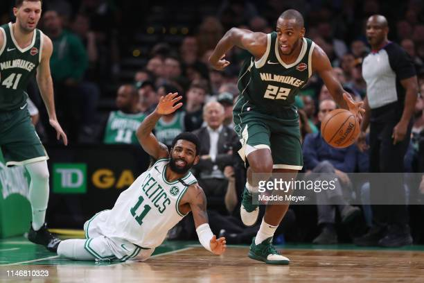 Kyrie Irving of the Boston Celtics dives after Khris Middleton of the Milwaukee Bucks during the second half of Game 3 of the Eastern Conference...