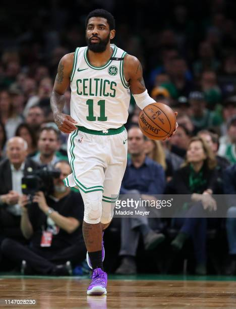 Kyrie Irving of the Boston Celtics dribbles against the Milwaukee Bucks during the first quarter of Game 3 of the Eastern Conference Semifinals of...