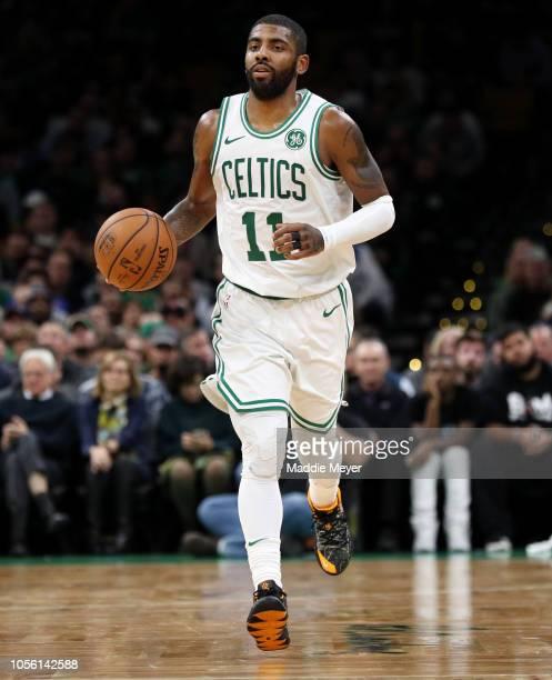 Kyrie Irving of the Boston Celtics dribbles during the game between the Boston Celtics and the Milwaukee Bucks at TD Garden on November 1 2018 in...