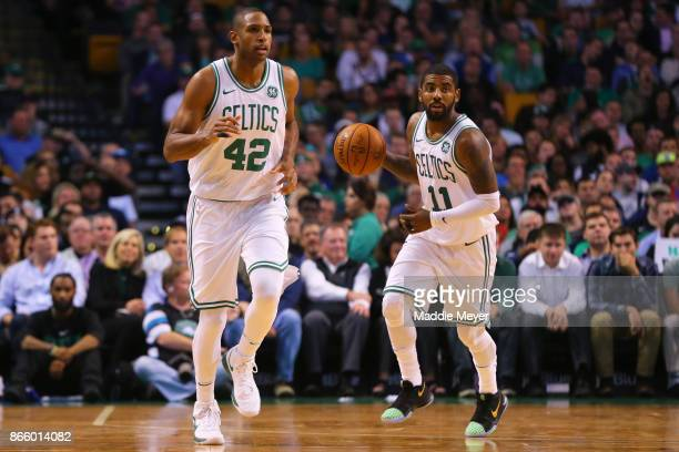 Kyrie Irving of the Boston Celtics dribbles past Al Horford during the first half against the New York Knicks at TD Garden on October 24 2017 in...