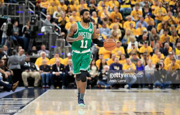 Kyrie Irving of the Boston Celtics dribbles the ball against the Indiana Pacers in game three of the first round of the 2019 NBA Playoffs at Bankers...