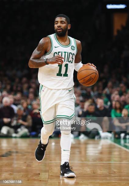 Kyrie Irving of the Boston Celtics dribbles the ball during the second half against the Toronto Raptors at TD Garden on November 16 2018 in Boston...