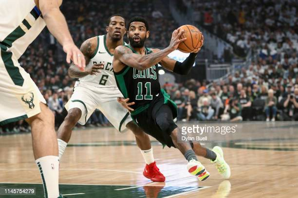 Kyrie Irving of the Boston Celtics dribbles the ball while being guarded by Eric Bledsoe of the Milwaukee Bucks in the first quarter during Game One...