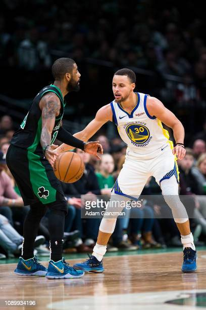 Kyrie Irving of the Boston Celtics dribbles the ball while guarded by Stephen Curry of the Golden State Warriors during a game at TD Garden on...