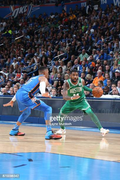 Kyrie Irving of the Boston Celtics dribbles the ball while guarded by Russell Westbrook of the Oklahoma City Thunder on November 3 2017 at Chesapeake...