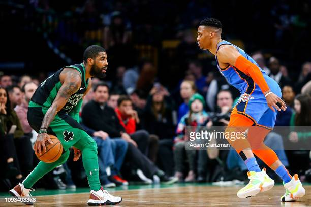 Kyrie Irving of the Boston Celtics dribbles while guarded by Russell Westbrook of the Oklahoma City Thunder r during a game at TD Garden on February...