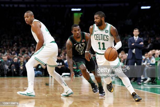 Kyrie Irving of the Boston Celtics drives against Eric Bledsoe of the Milwaukee Bucks at TD Garden on November 1 2018 in Boston Massachusetts