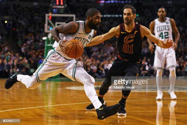 Kyrie Irving of the Boston Celtics drives against Jose Calderon of the Cleveland Cavaliers during the first quarter at TD Garden on January 3 2018 in...
