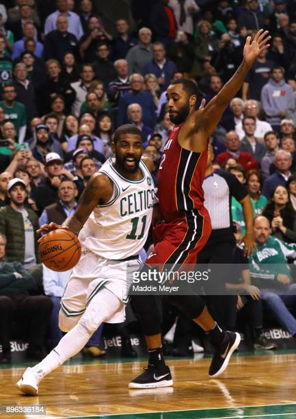 Kyrie Irving of the Boston Celtics drives against Wayne Ellington of the Miami Heat during the second half at TD Garden on December 20 2017 in Boston...