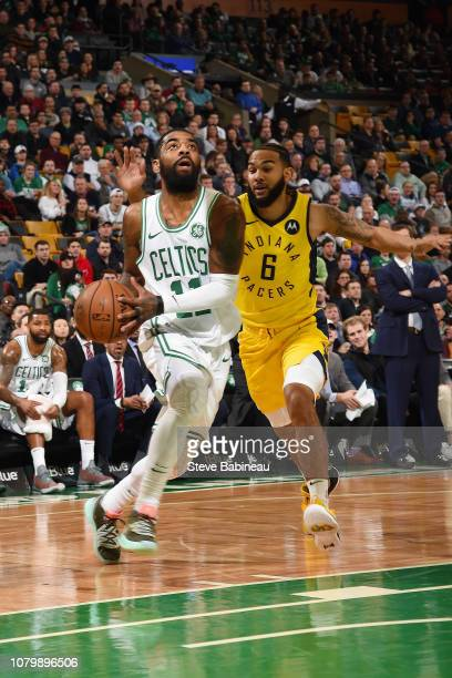Kyrie Irving of the Boston Celtics drives through the paint during the game against Cory Joseph of the Indiana Pacers on January 9 2019 at the TD...