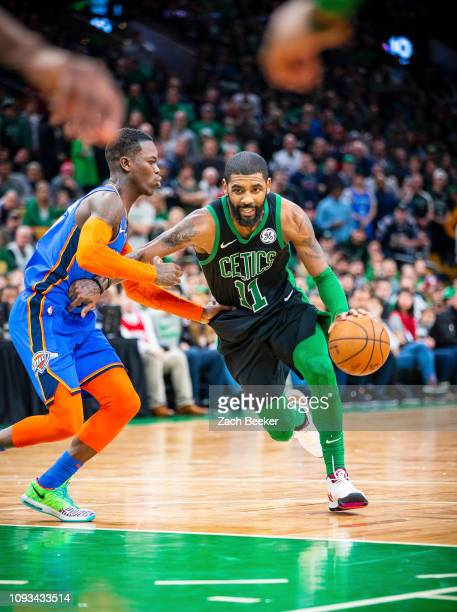 Kyrie Irving of the Boston Celtics drives through the paint during the game against Dennis Schroder of the Oklahoma City Thunder on February 3 2019...