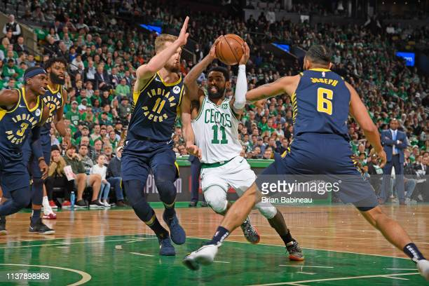 Kyrie Irving of the Boston Celtics drives through the paint during the game against Domantas Sabonis of the Indiana Pacers in Game Two of Round One...